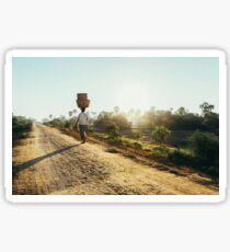 Woman Carrying Baskets on Head Walking in Burmese Countryside in Early Morning Sticker