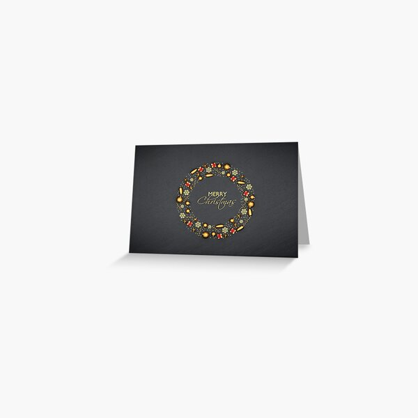 "A circle of flat lay golden christmas ornaments on a black stone plate. Text ""Merry Christmas"" inside. Greeting Card"