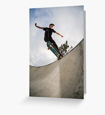 Skateboarder doing a tail slide Greeting Card