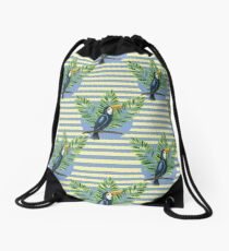 Toucan and banana leaves on the striped background Drawstring Bag