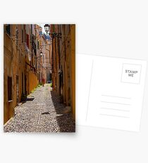 An alley in Alghero. Postcards