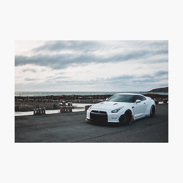 white wide body gtr on an overcast day Photographic Print