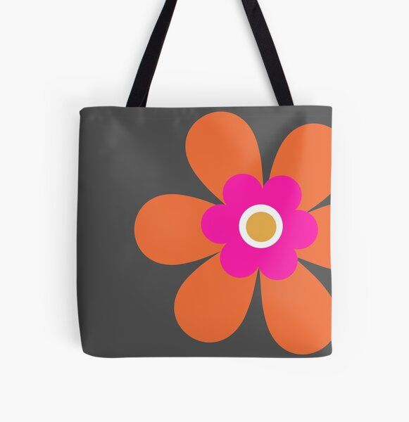 Calling all orange lovers! This vibrant retro 70s simple flower power block colour groovy graphic is in bright pink, orange and mustard yellow on dark slate grey All Over Print Tote Bag