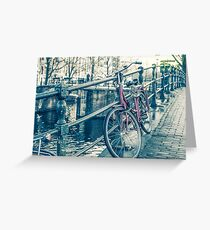 Amsterdam canal and bicycles Greeting Card