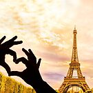The Eiffel Tower in Paris and hands in a heart shape by gianliguori