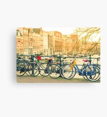 Amsterdam canal and bicycles Canvas Print