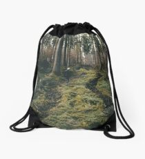 Boy walking through mystic forest landscape photography Drawstring Bag