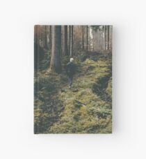 Boy walking through mystic forest landscape photography Hardcover Journal