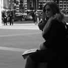 Woman on mobile phone in Victoria by joelmeadows1