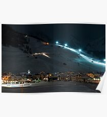 Ski village at night with slope lights, cross-country ski run, buildings, ice monument - shot in Livigno, Italian Alps Poster