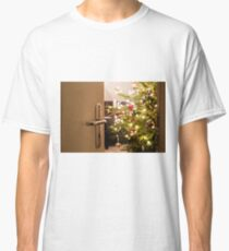 Interior shot of a modern living room with a Christmas tree as seen through the living room door Classic T-Shirt