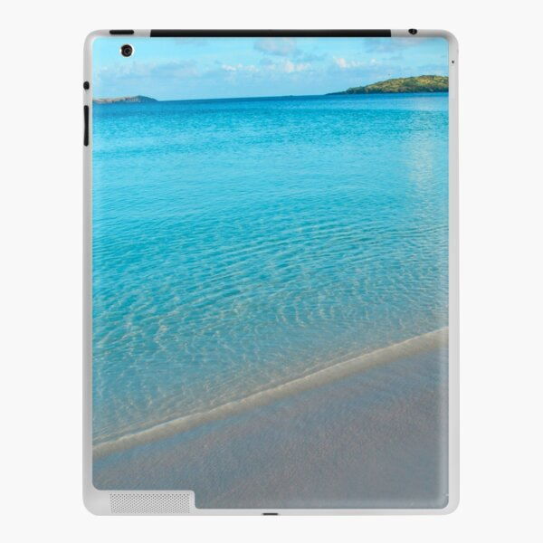 Turquoise white-sand beach in the morning iPad Skin