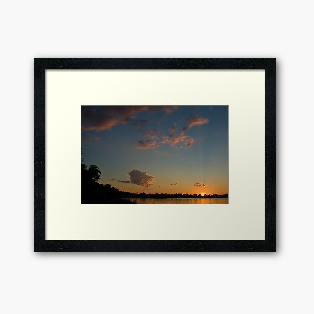 Sunset over the water Framed Art Print