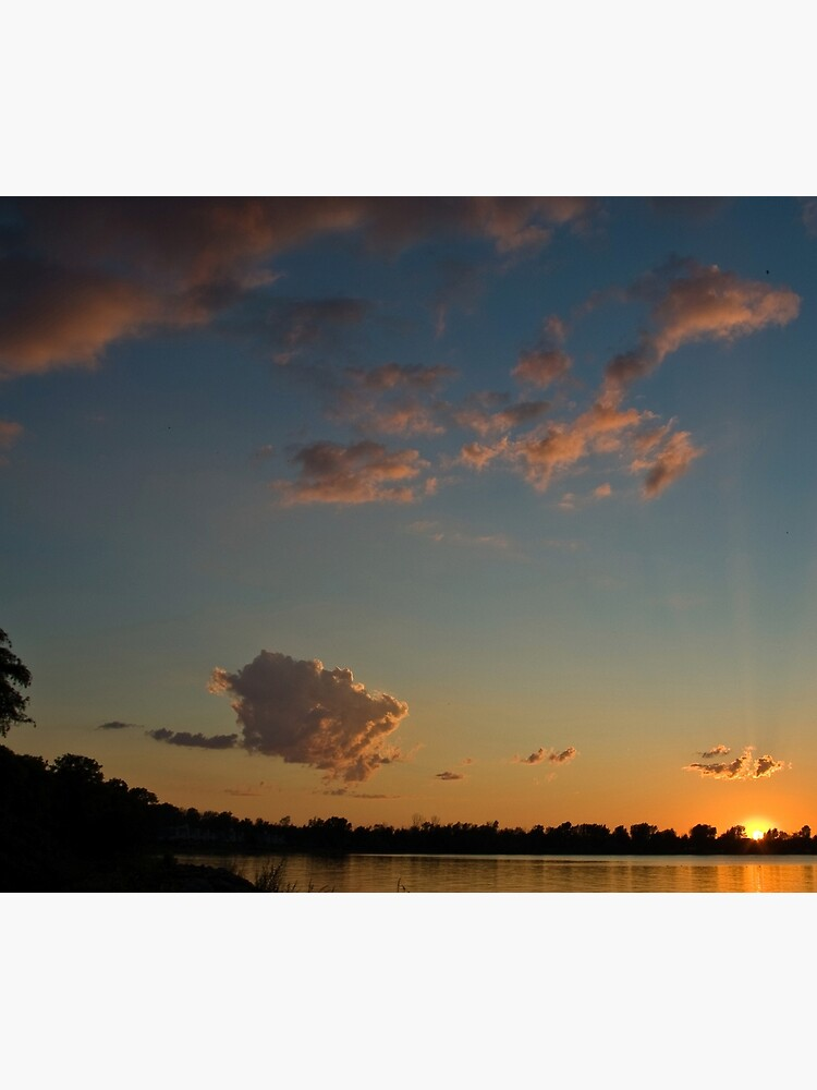 Sunset over the water by daveriganelli