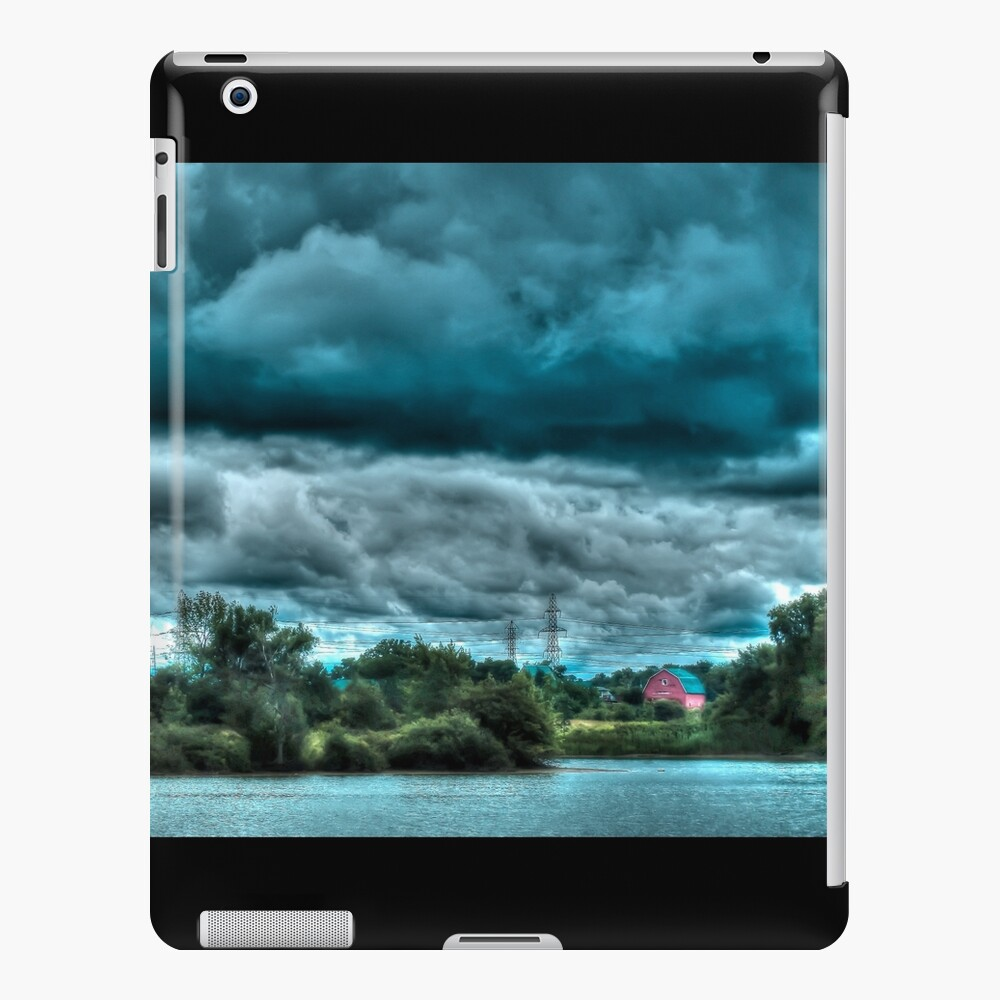 Red barn under cloudy sky iPad Case & Skin