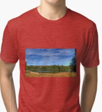 Forest under blue sky Tri-blend T-Shirt
