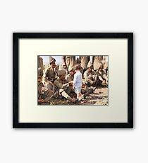 A French boy introduces himself to Indian soldiers who had just arrived in France to fight alongside French and British forces, Marseilles, 30th September 1914 Framed Print