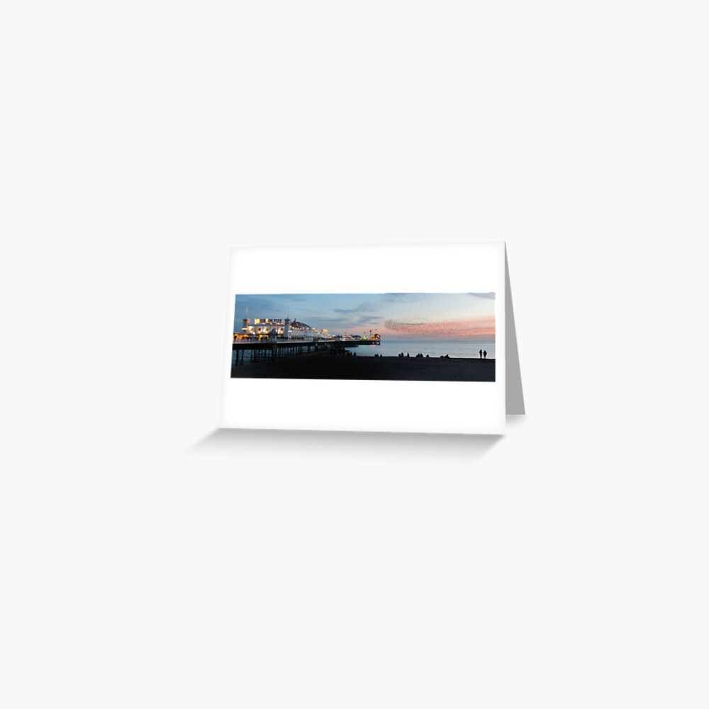 Brighton Pier at Sunset with a murmuration of Starlings flying above. Greeting Card