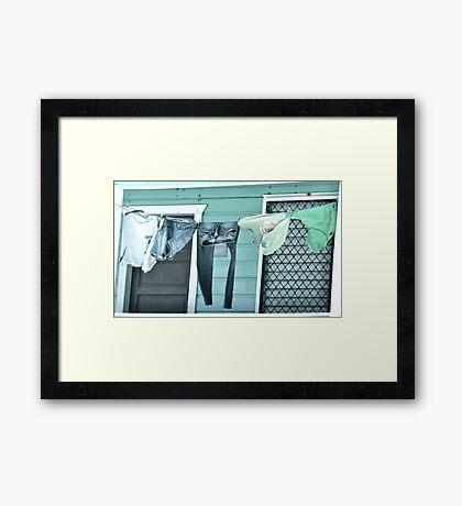 One Man's Washing Framed Print