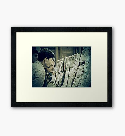 Men and the News Framed Print
