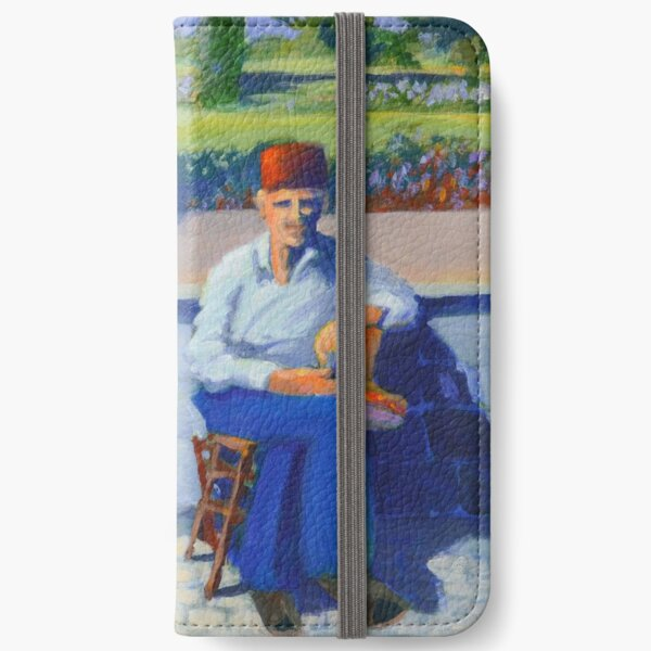 Man sitting by a wall iPhone Wallet