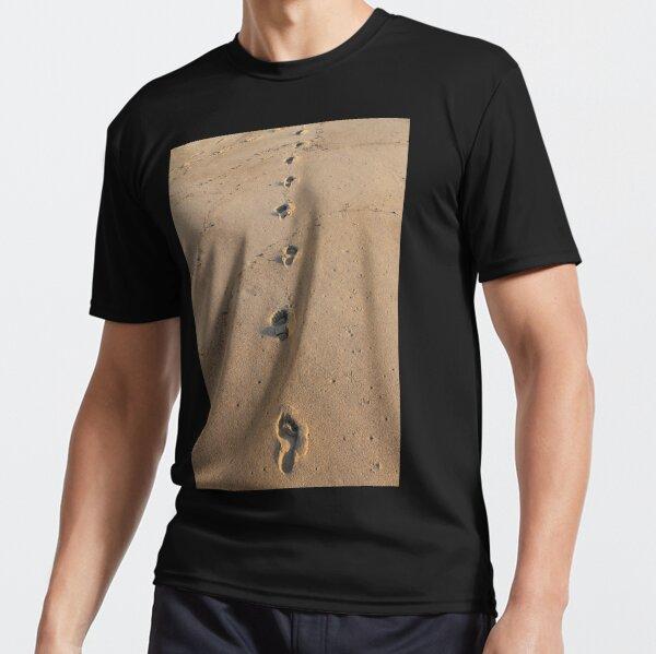 Bare footprints on the coastal sand Active T-Shirt