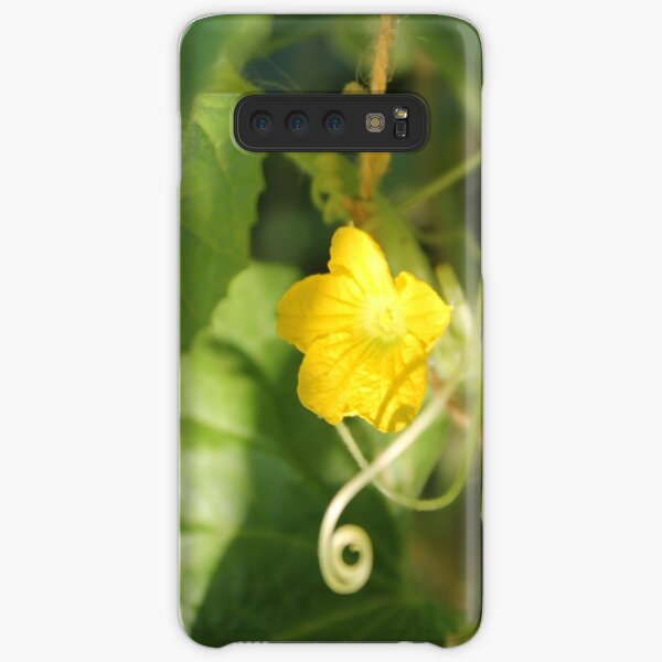Yellow unnamed flower on a background of green leaves Samsung Galaxy Snap Case