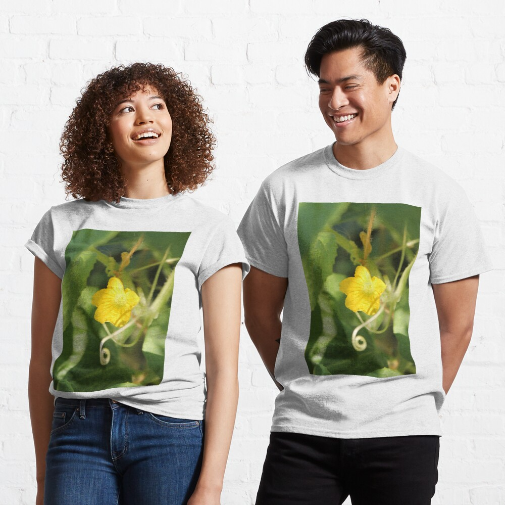 Yellow unnamed flower on a background of green leaves Classic T-Shirt