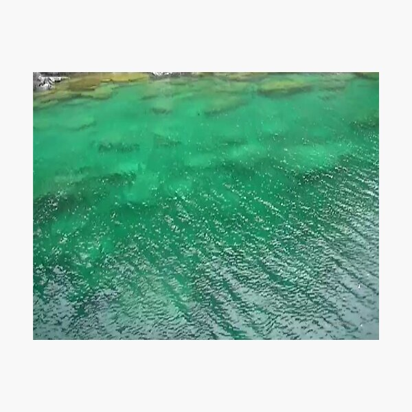 Stones Across The Water-Emerald Green water with stones and waves Photographic Print