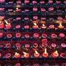 Burning Candles of Santa Nino Basilica by Bo Insogna