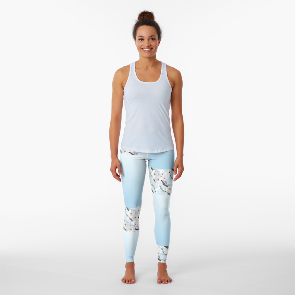Baby blue background with white flowers as trim Leggings