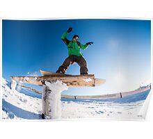 Snowboarder sliding on a rail Poster