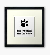 Hugged Cat Framed Print