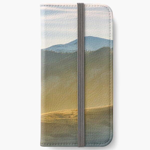 rural hill in glowing fog iPhone Wallet