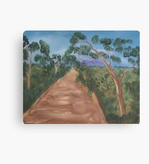 Gum trees along a dirt road. Canvas Print