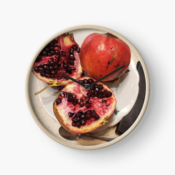 Three pomegranate fruits, spoon, plate, and purse Clock