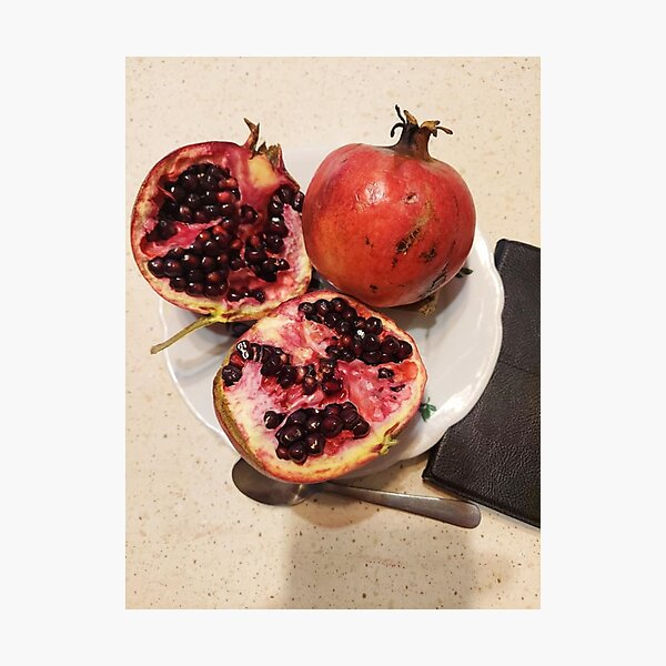 Three pomegranate fruits, spoon, plate, and purse Photographic Print