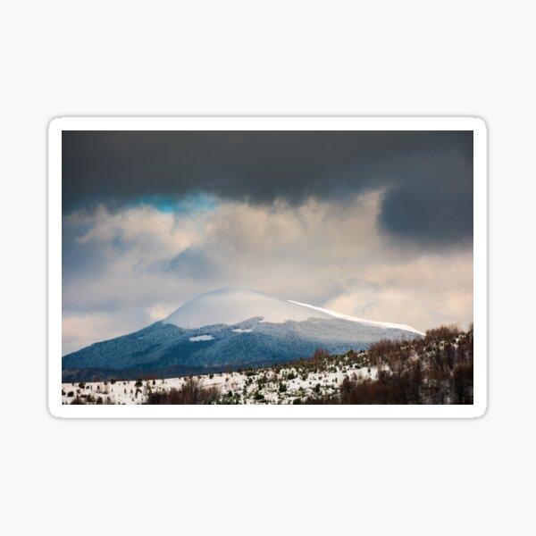 dramatic sky above the distant snowy peak Sticker