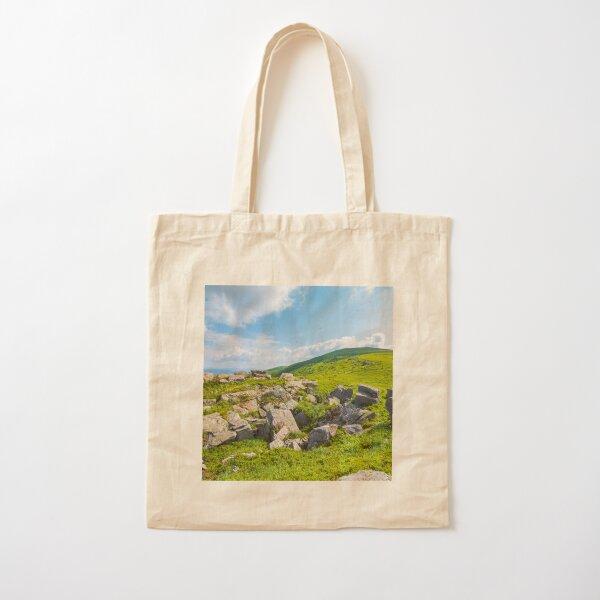 grassy slope with huge rocks Cotton Tote Bag