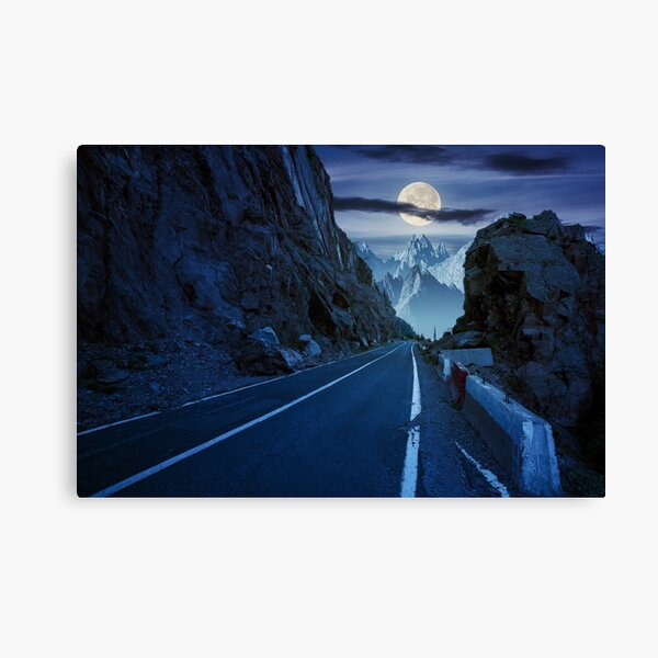 road in to the high mountains at night Canvas Print