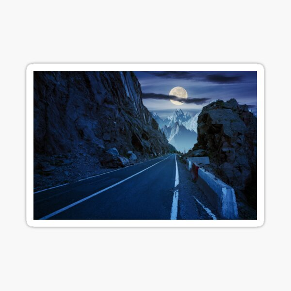 road in to the high mountains at night Sticker