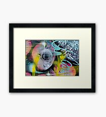Colorful Graffiti on the textured wall Framed Print