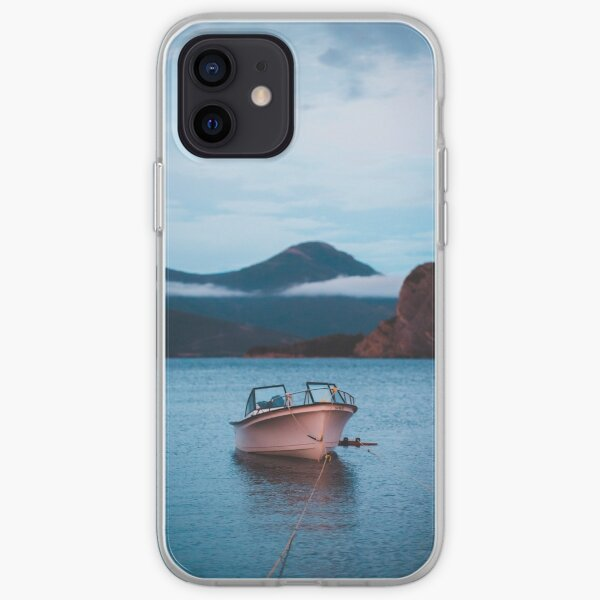 Tranquil boat in the water at sunset iPhone Soft Case