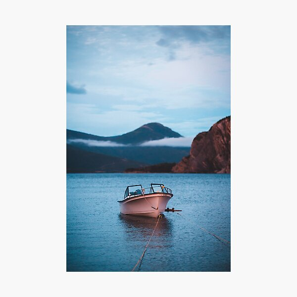 Tranquil boat in the water at sunset Photographic Print