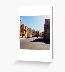Man Riding Bicycle Through Moroccan Suburb Greeting Card