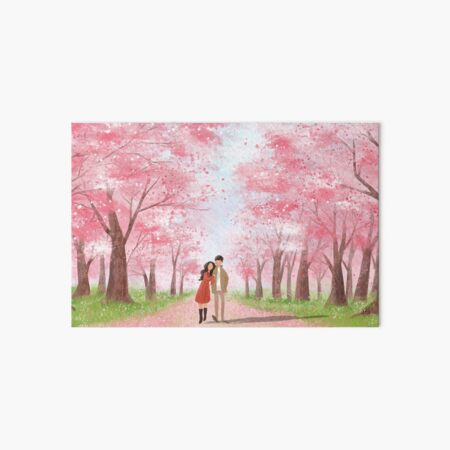 Beautiful young couple holding hands and walking through pink flowering trees. Wonderful view of spring bloom, romantic environment. Art Board Print