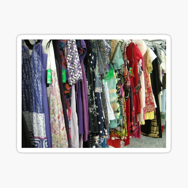 an op shop rack full of bright colourful hippy clothes Sticker