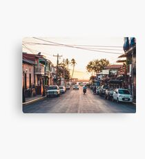 Sun sets in the village Canvas Print