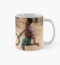 A Child Playing With A Wheel in Myanmar Mug