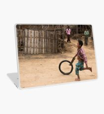 A Child Playing With A Wheel in Myanmar Laptop Skin